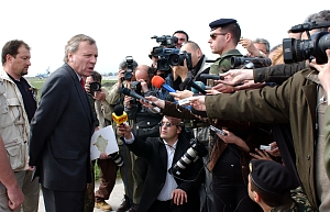 mass media   beyond intractabilitynato secretary general  jaap de hoop scheffer  addresses members of the press in pristina  kosovo  on april      this is an official nato photograph